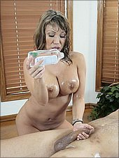 Horny brunette milf masseuse gives slippery blowjob massage